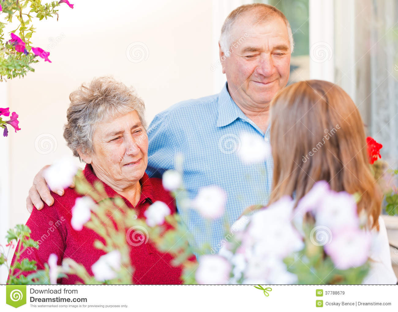 Happy elderly couple talking with the therapist Happy Elderly Couple