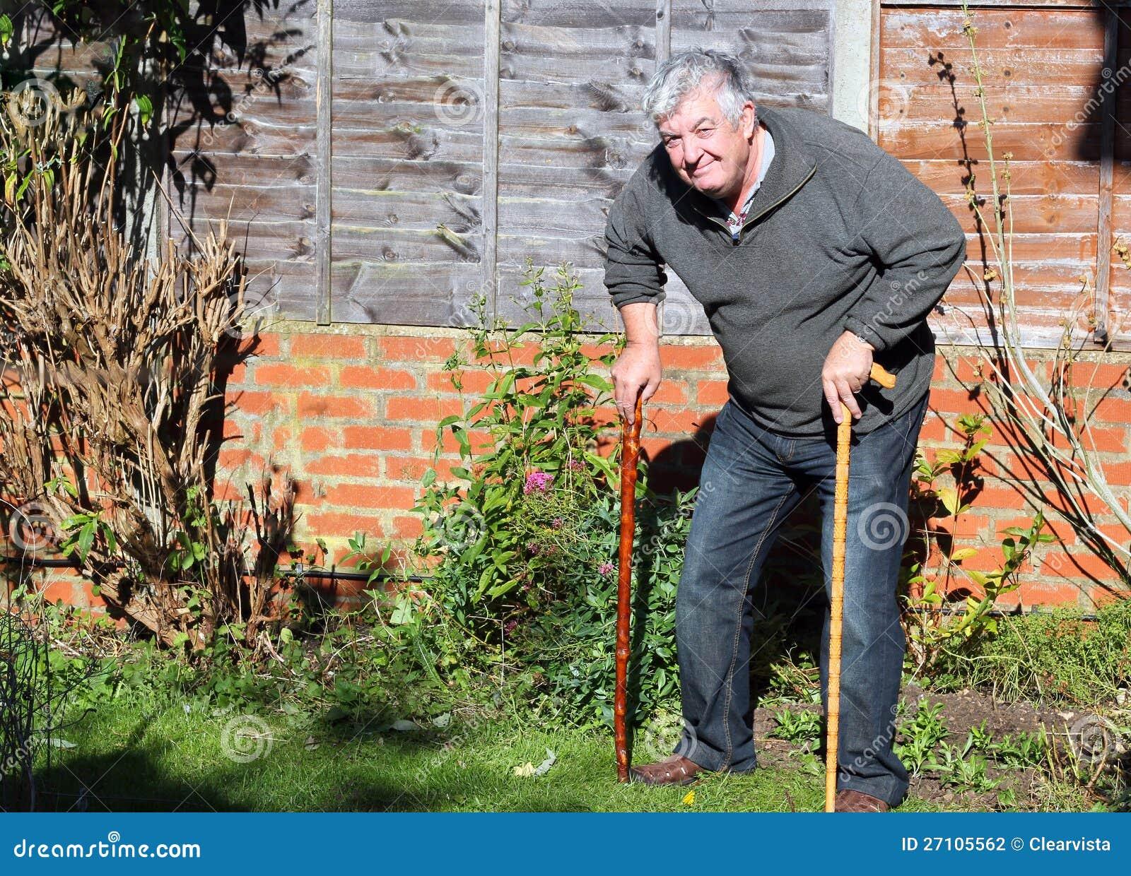 happy-elderly-man-two-walking-sticks-27105562.jpg