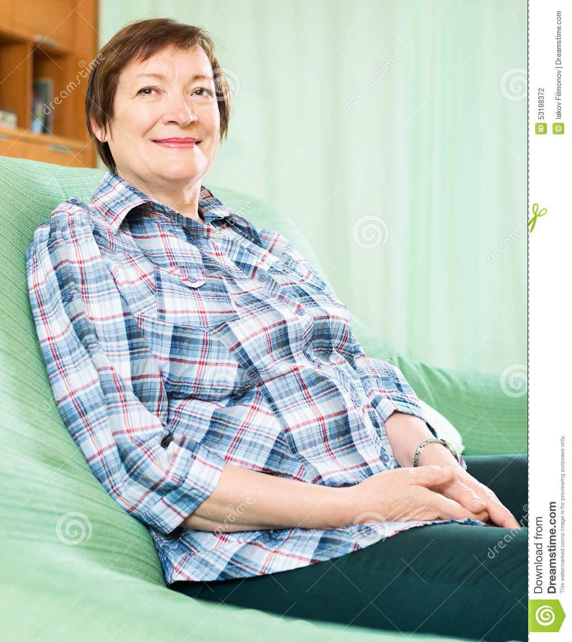 Happy Elderly Woman In Casual Clothes Sitting On Sofa Stock Photo Image 53198372