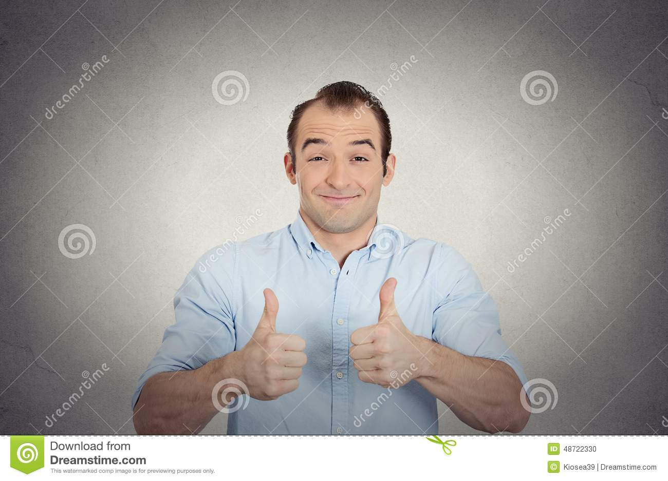 Happy, excited surprised young man showing thumbs up
