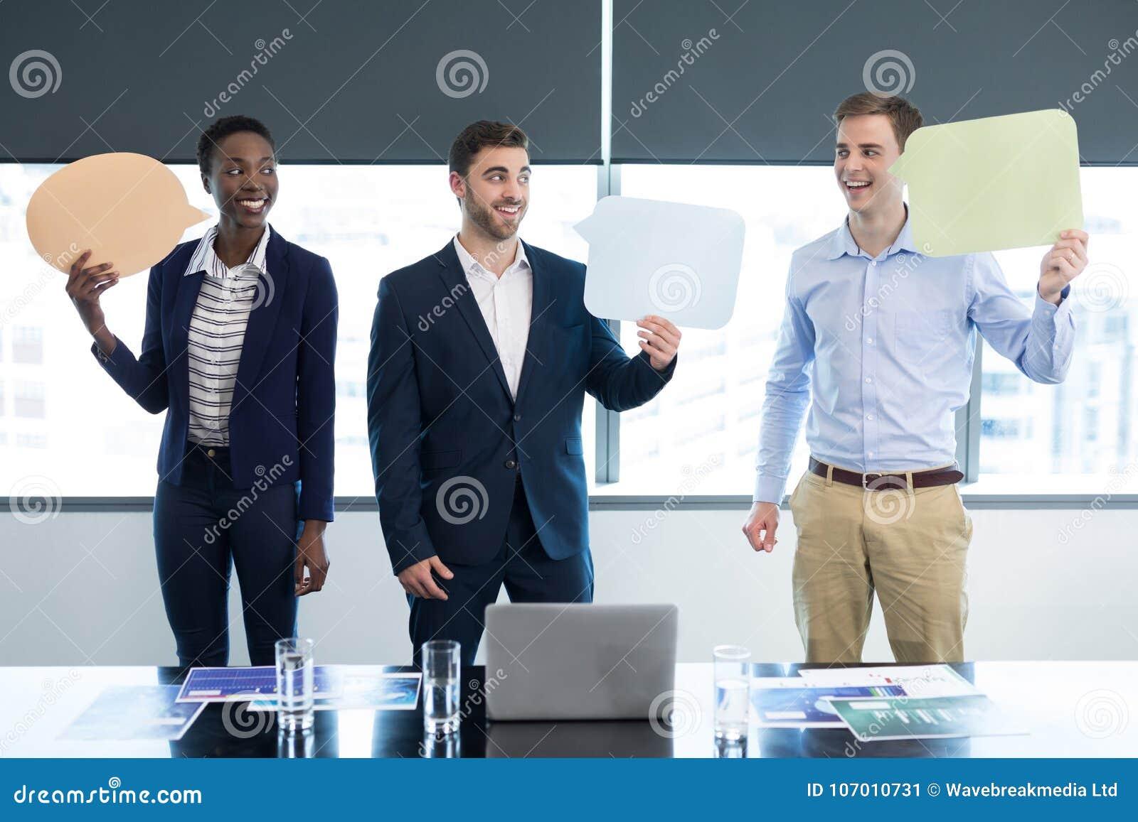 Happy executives holding speech bubble