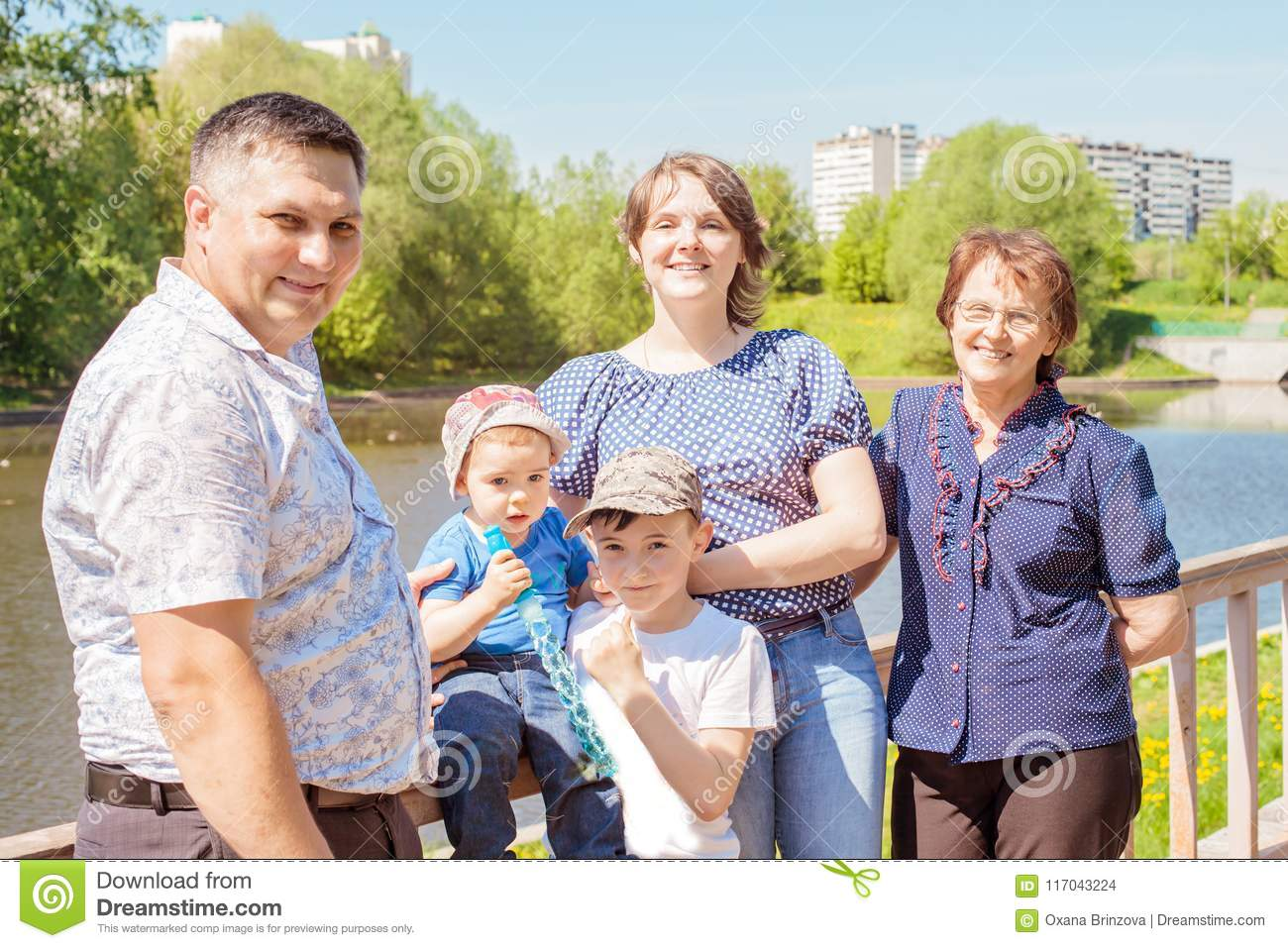 Happy famHappy family spending time outdoors on a Sunny summer day. mom, dad ,grandma and two boys