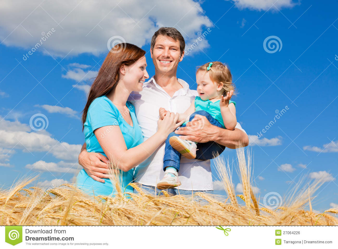Father Daughter And Mother Enjoying Life Outdoor In Field