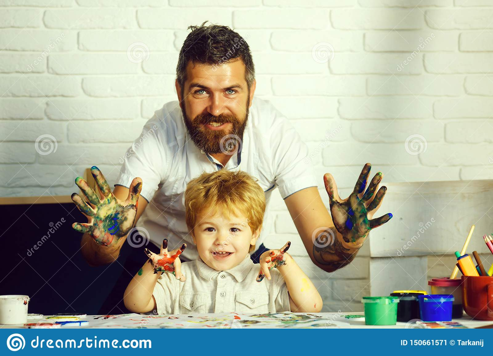 Happy family art. Colorful hands concept. Father and son friendship. Family weekend.