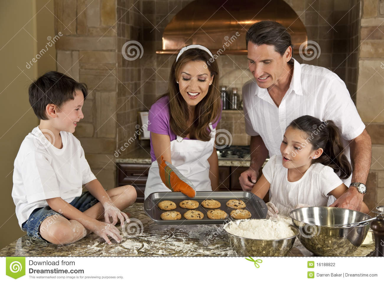 Happy family in kitchen - Happy Family Baking Eating Cookies In A Kitchen Stock Photography