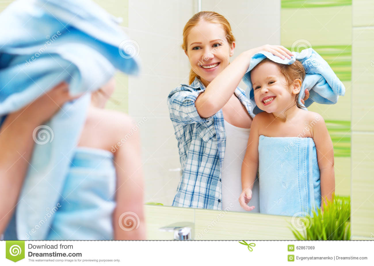 Happy Family In Bathroom Mother Of A Child With Towel Dry Hair