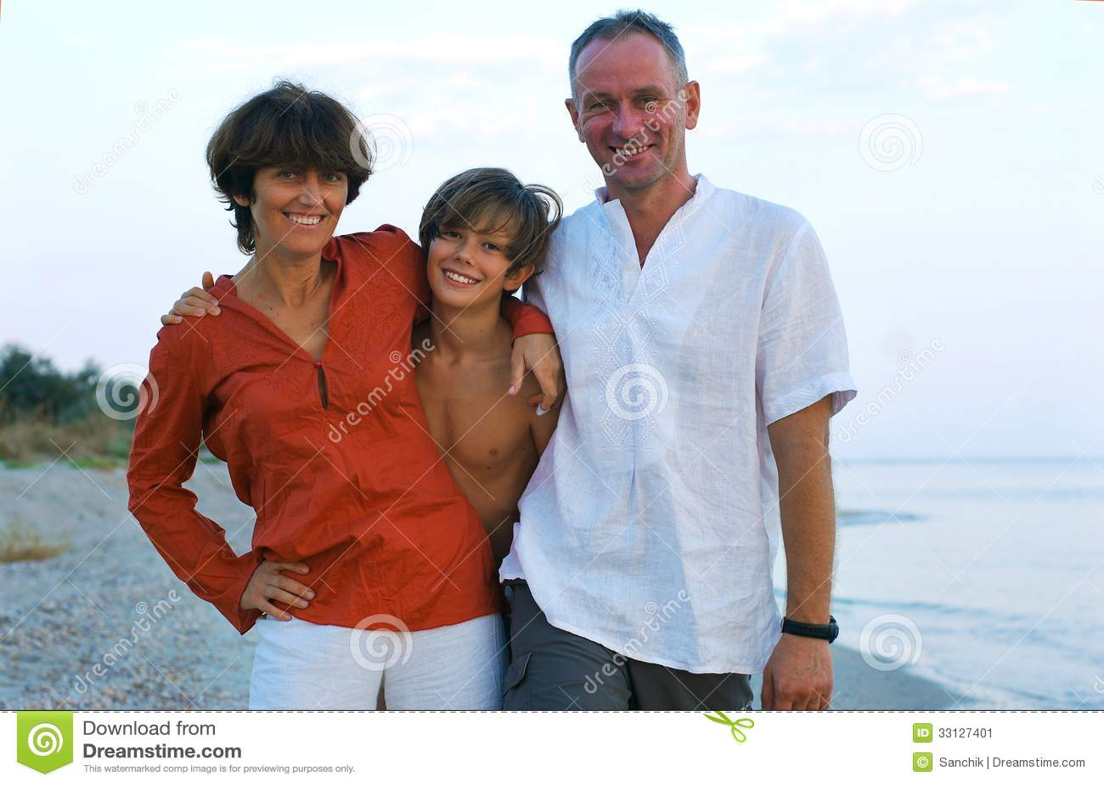 Happy family on the beach.