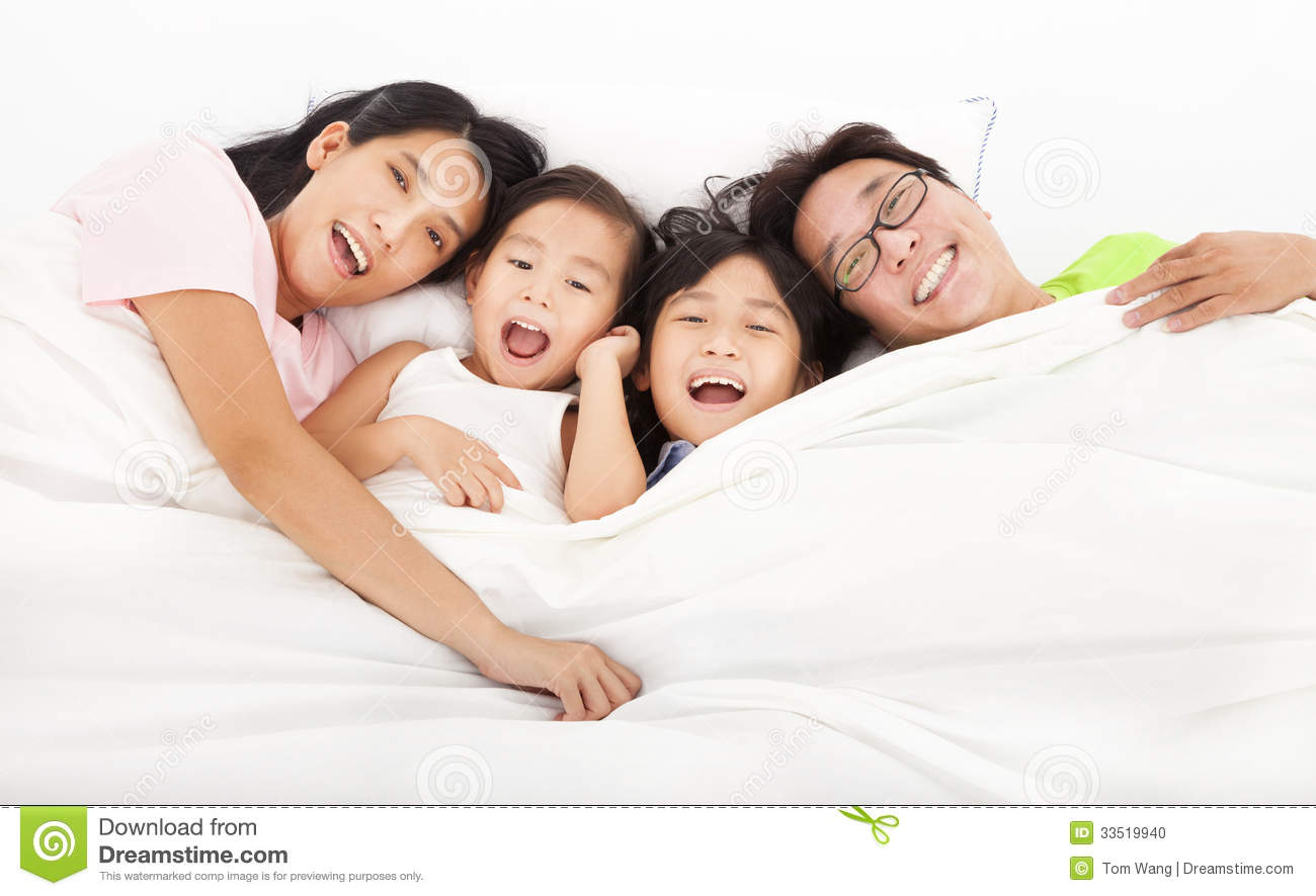 Happy Family On The Bed Stock Photo - Image: 33519940