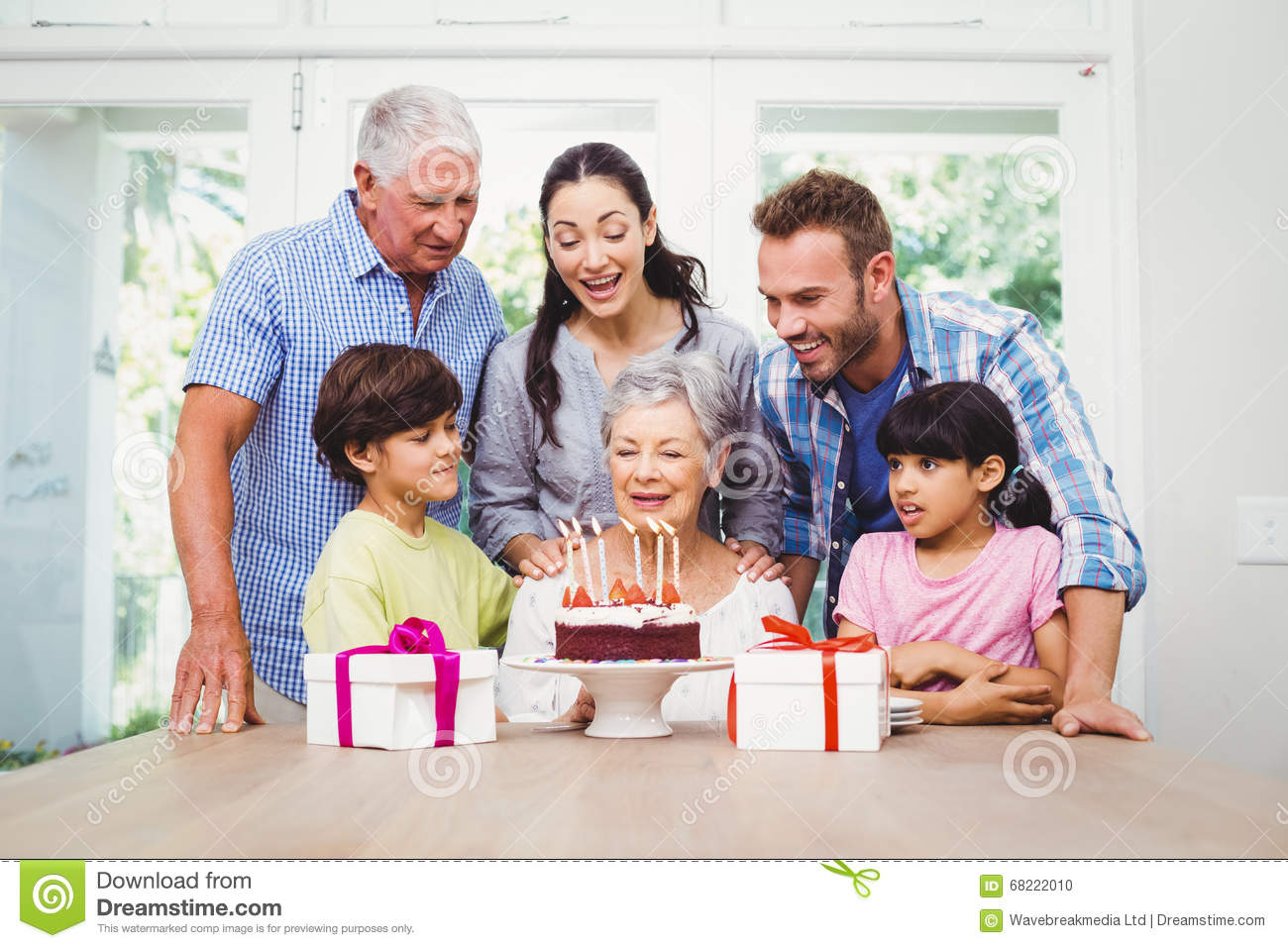 Happy Family During Birthday Party Of Granny Stock Photo