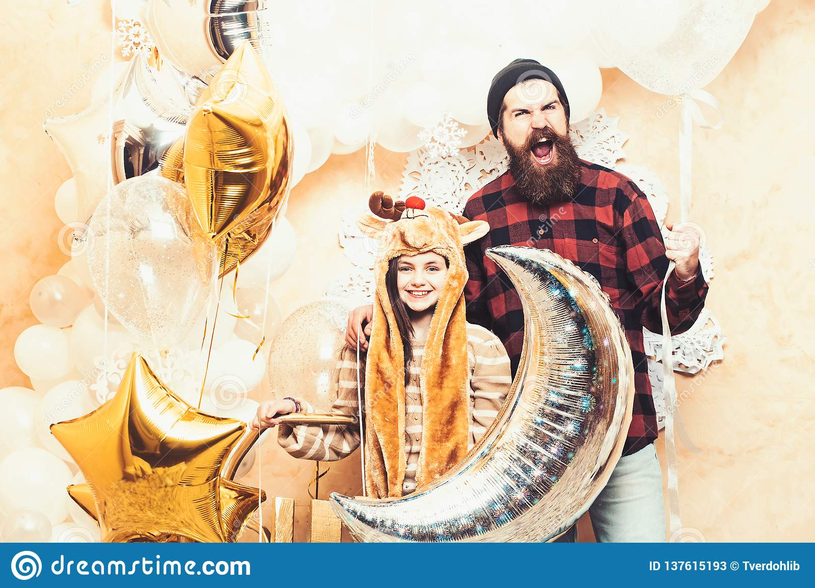 Happy family celebrate christmas and new year. Father and daughter smile with balloons, christmas. Man hipster and child
