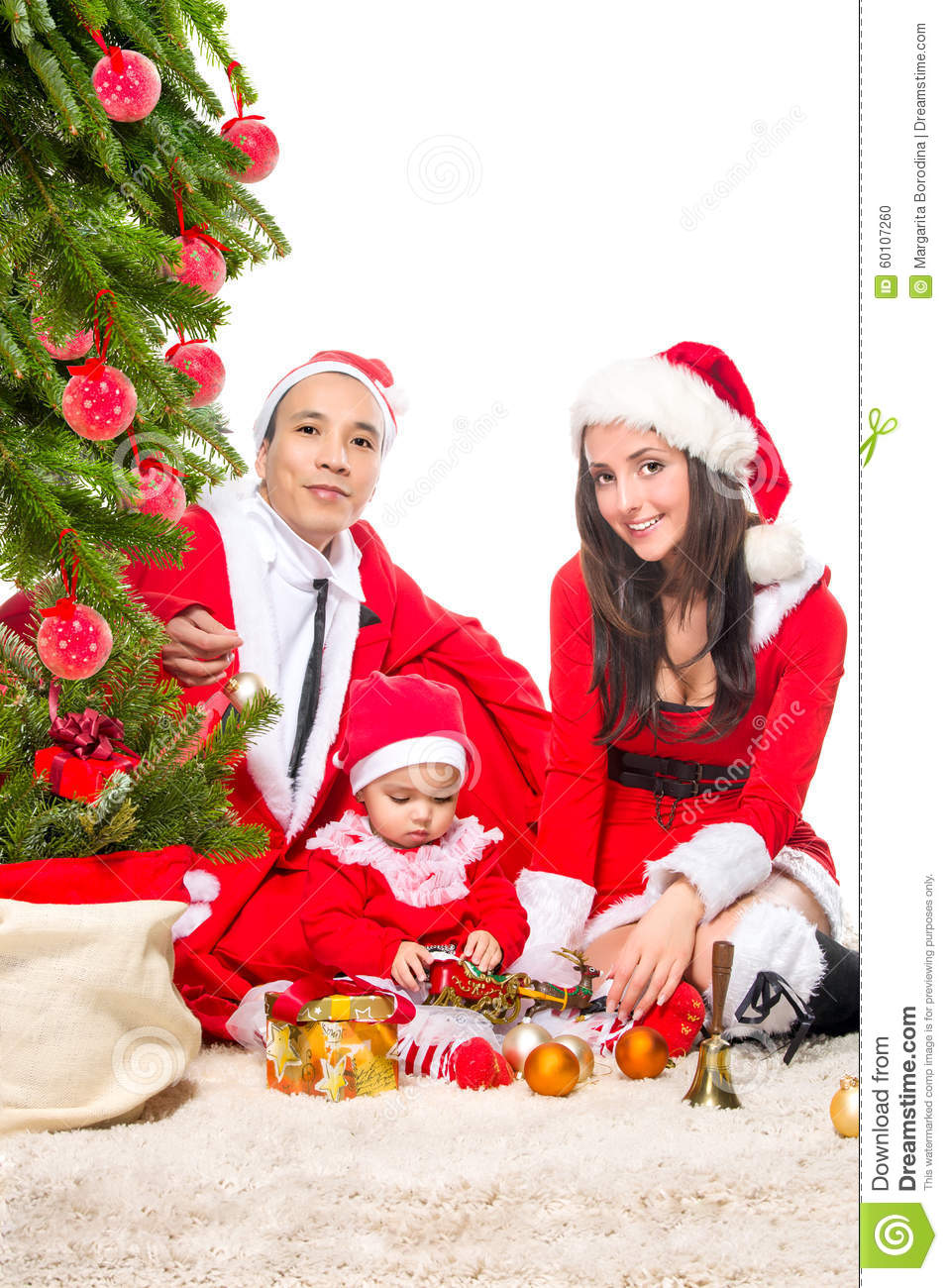 Happy family in christmas eve at home sitting near stock