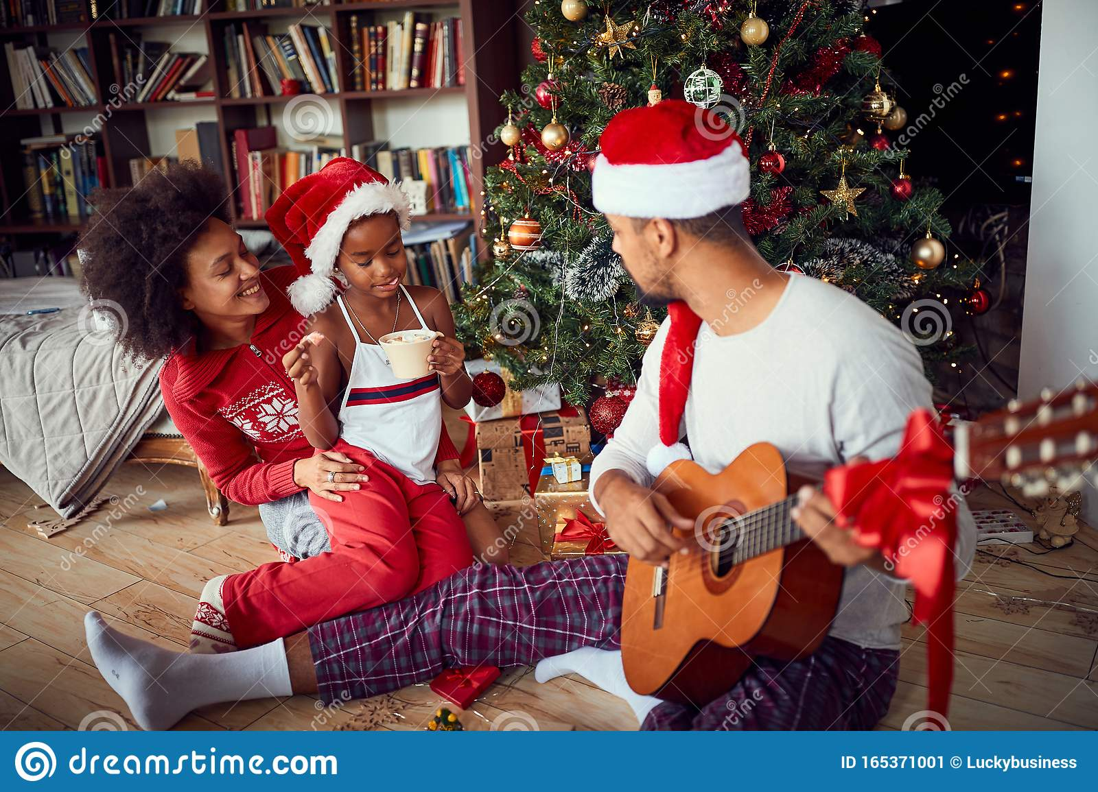 Family At Christmas Morning Sitting On Floor And Play Guitar Stock Image - Image of christmas ...