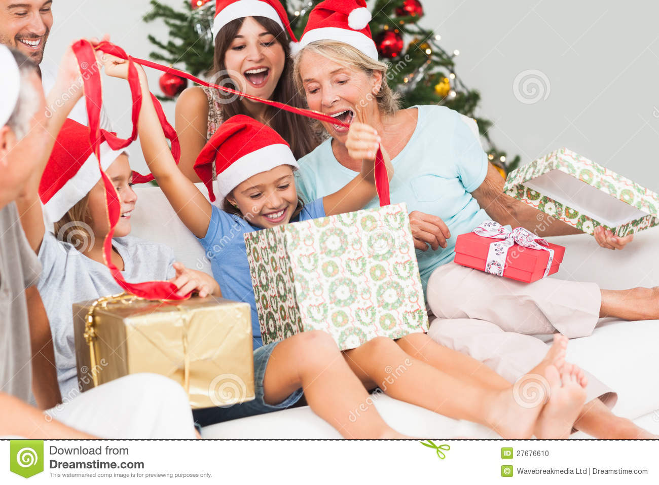 Happy family at christmas opening gifts together