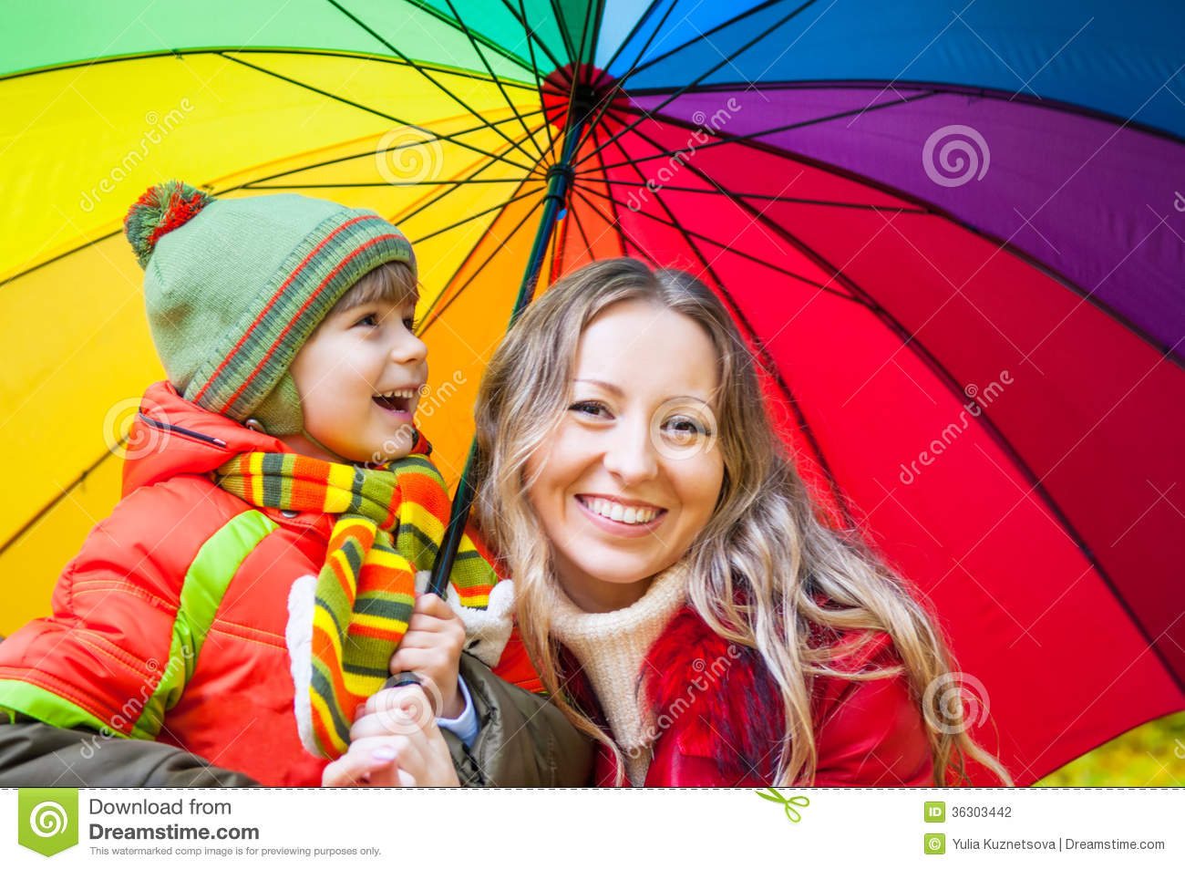 Happy Family With Colorful Umbrella In Autumn Park Stock Photo ...