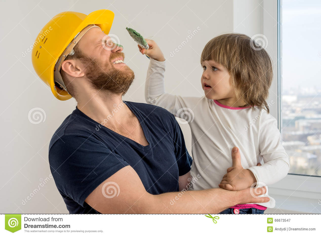 Happy family, construction worker in helmet and small child