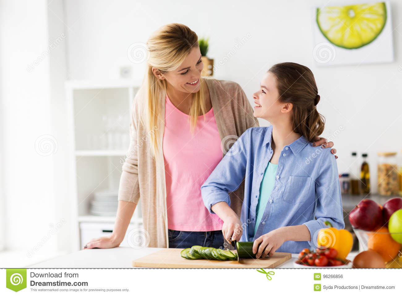 Happy Family Cooking Dinner At Home Kitchen Stock Photo