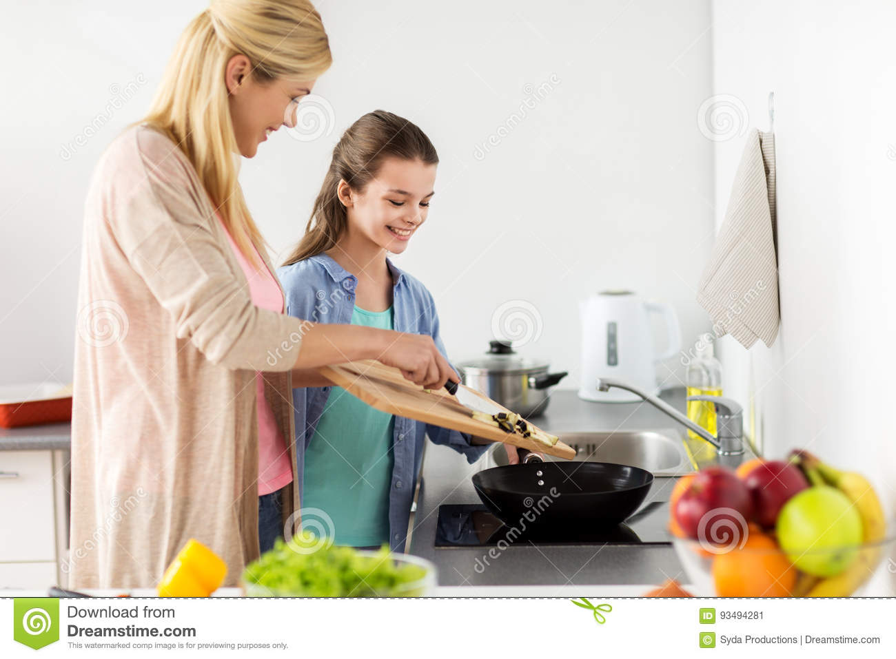 Family cooking kitchen - Happy Family Cooking Food At Home Kitchen Stock Image