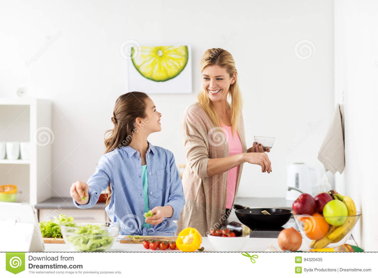 Happy family in kitchen - Concept Cooking Daughter Dinner Family Food Frying Happy Home Kitchen