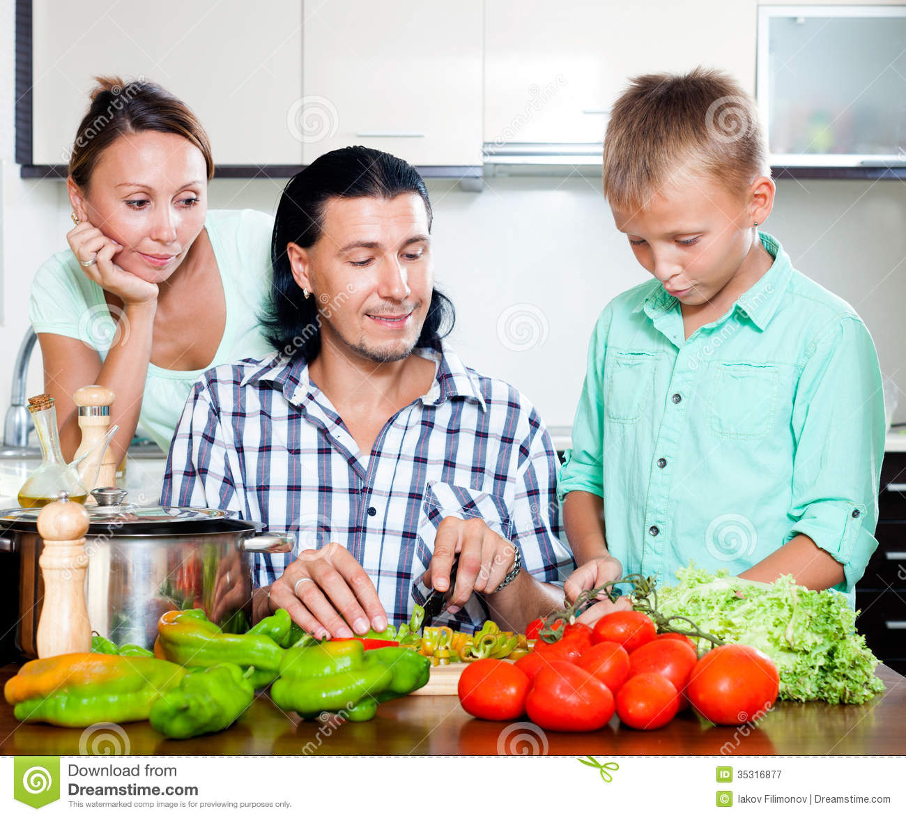 Happy family in kitchen - Cooking Family Happy Home Kitchen