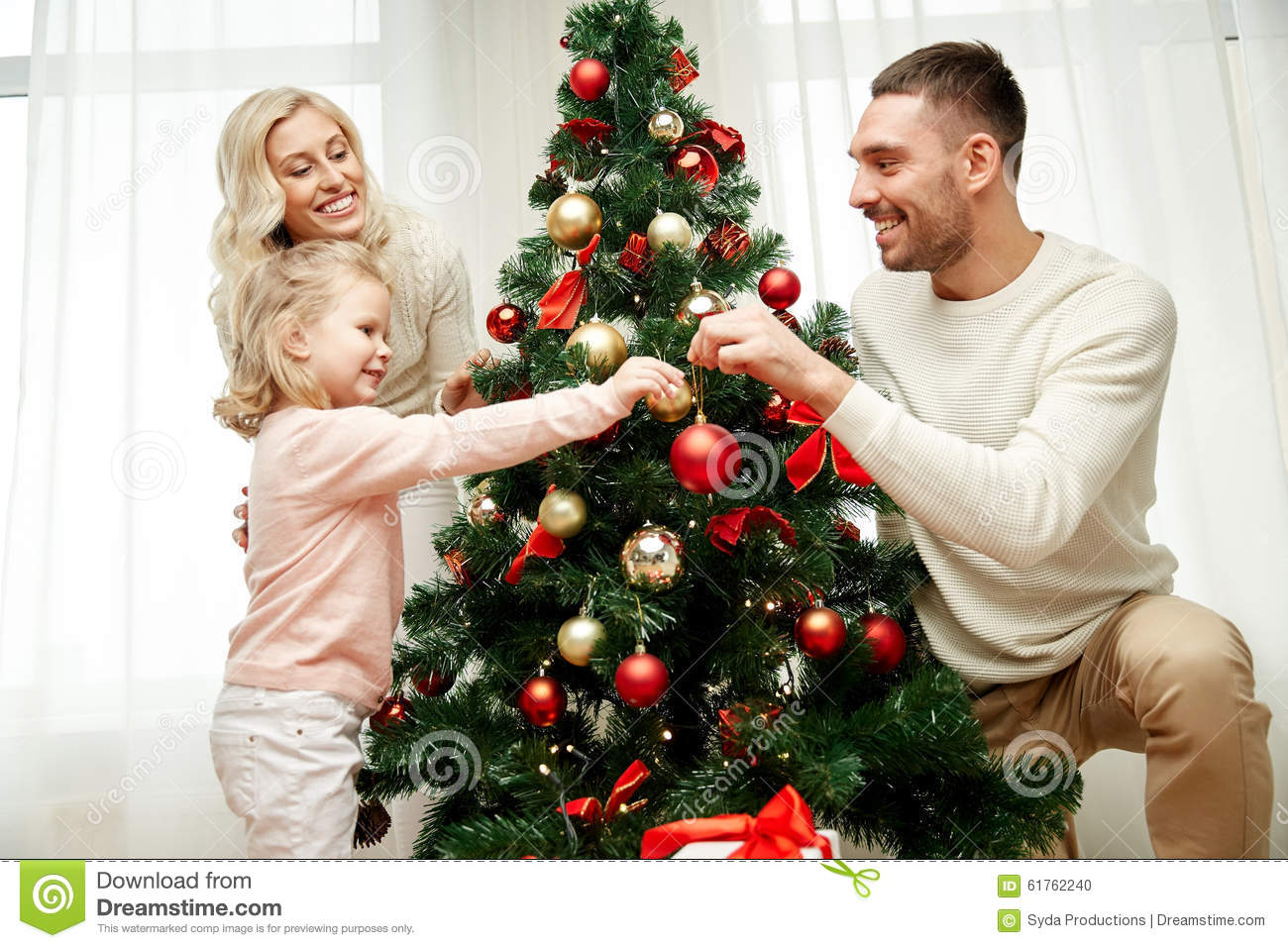 Happy Family Decorating Christmas Tree At Home Stock Photo - Image ...
