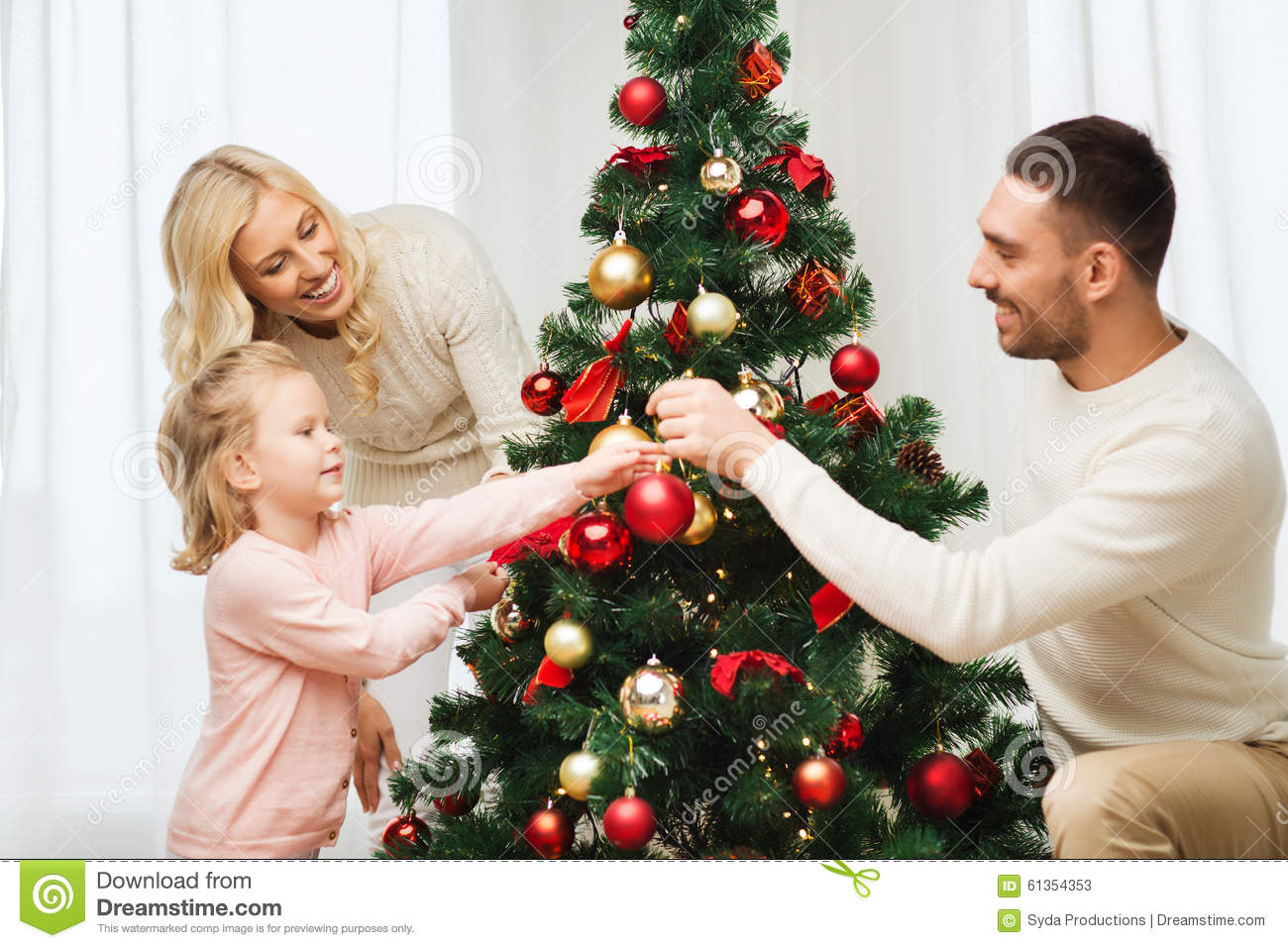 Happy Family Decorating Christmas Tree At Home Stock Photo ...