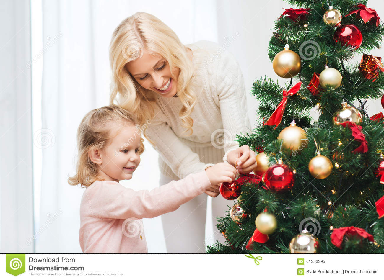 People Decorating For Christmas contemporary people decorating christmas tree royalty free stock