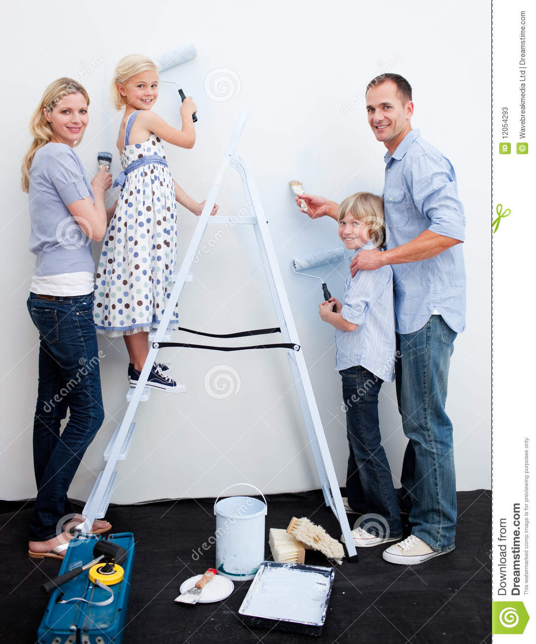 Happy Family Decorating Their New Home Stock Image - Image: 12054293