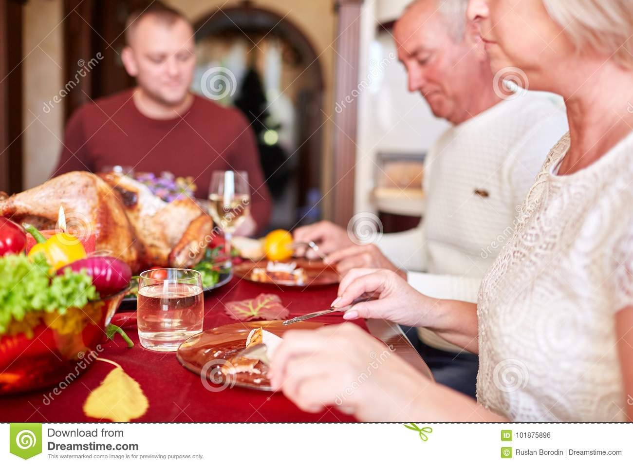 Happy family dining on Christmas on a blurred festive background. Celebrating Thanksgiving concept. Happy new year.