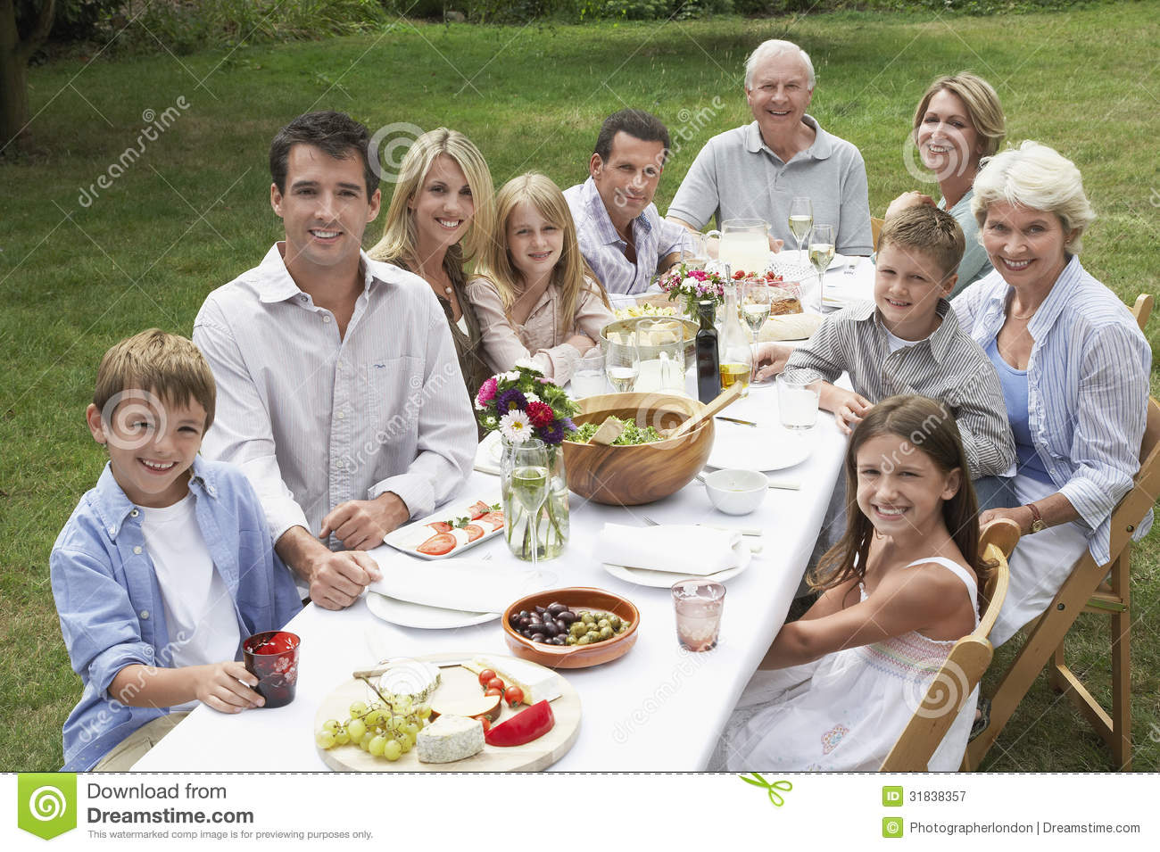 happy family dining together in garden royalty free stock