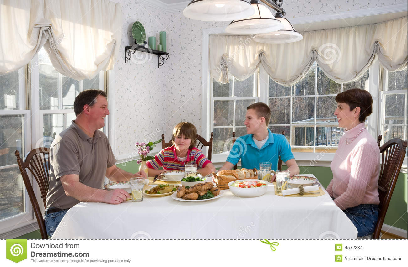Happy family eating at dinner table stock photo image of for Eating table