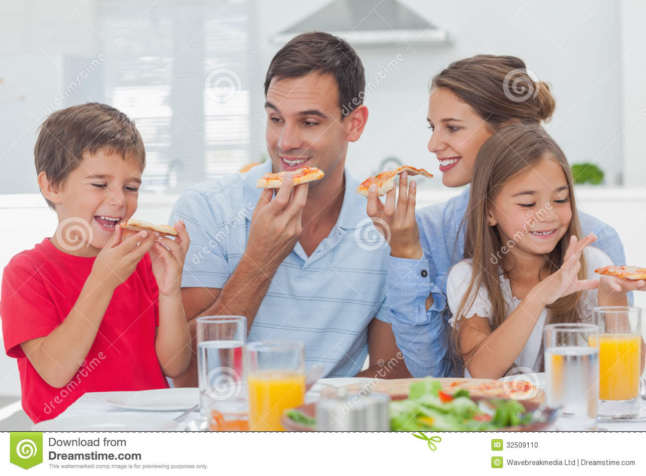 Happy Family Eating Pizza Slices Stock Photo - Image of ...