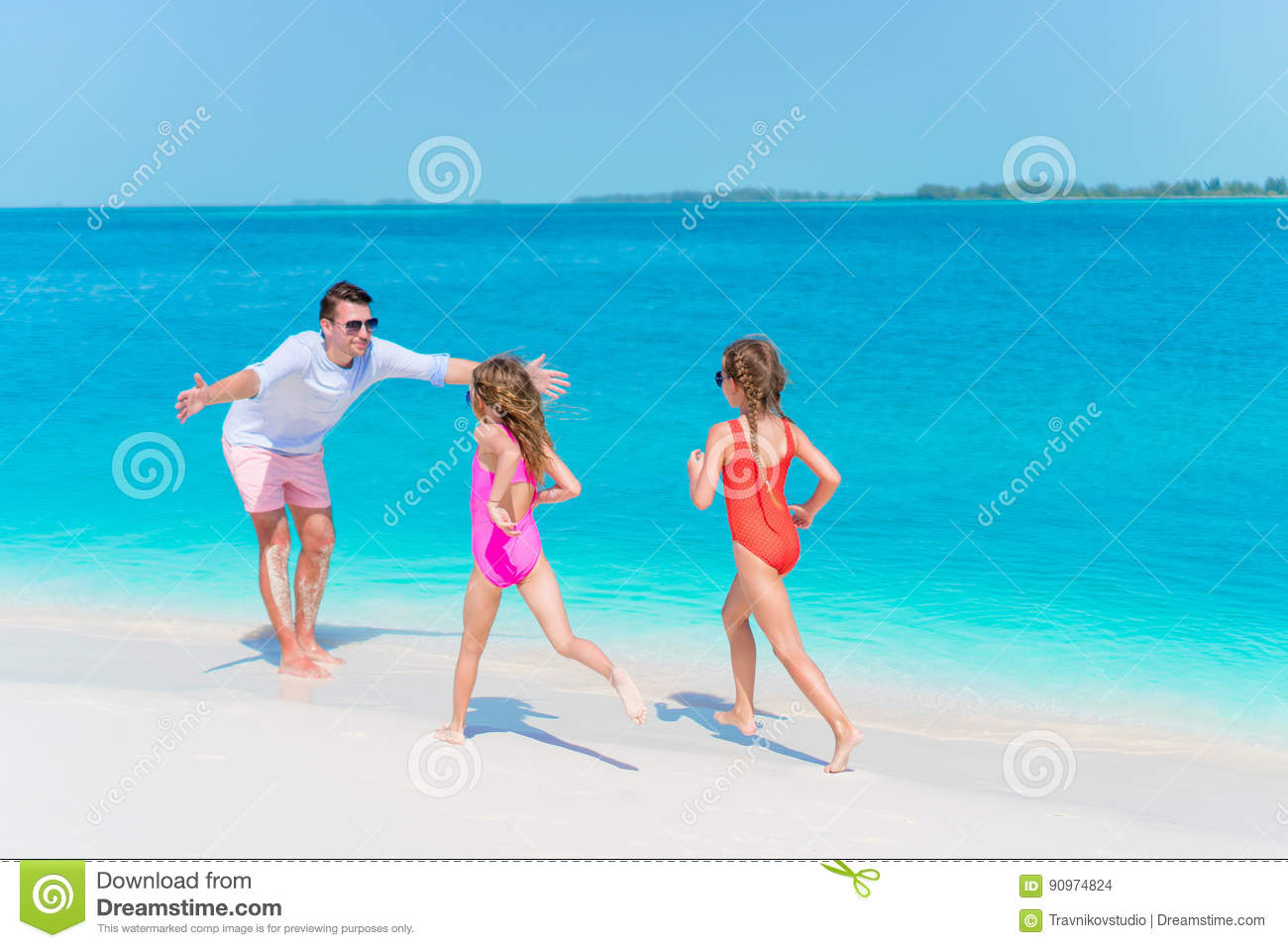 Happy Family Enjoying Beach Time And Have A Lot Of Fun Stock Photo