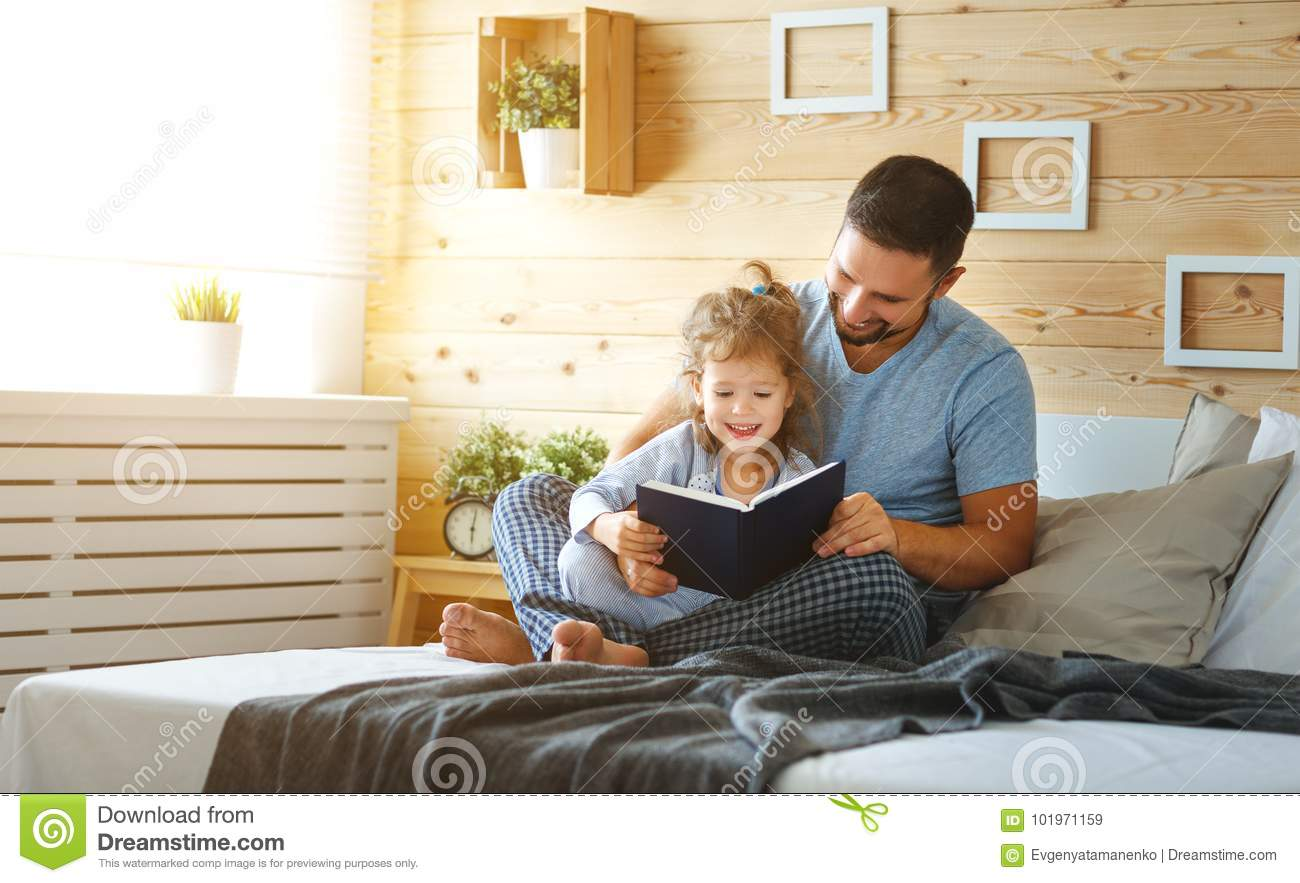 Download Happy Family Father And Daughter Reading Book In Bed Stock Image - Image of education, leisure: 101971159