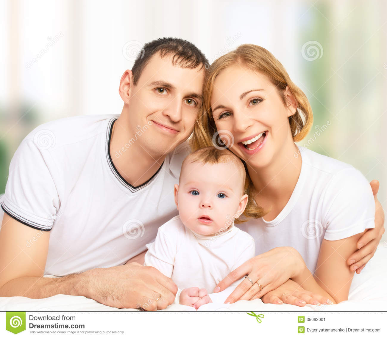 happy family of father mother and small baby girl daughter in stock image image of hugging. Black Bedroom Furniture Sets. Home Design Ideas