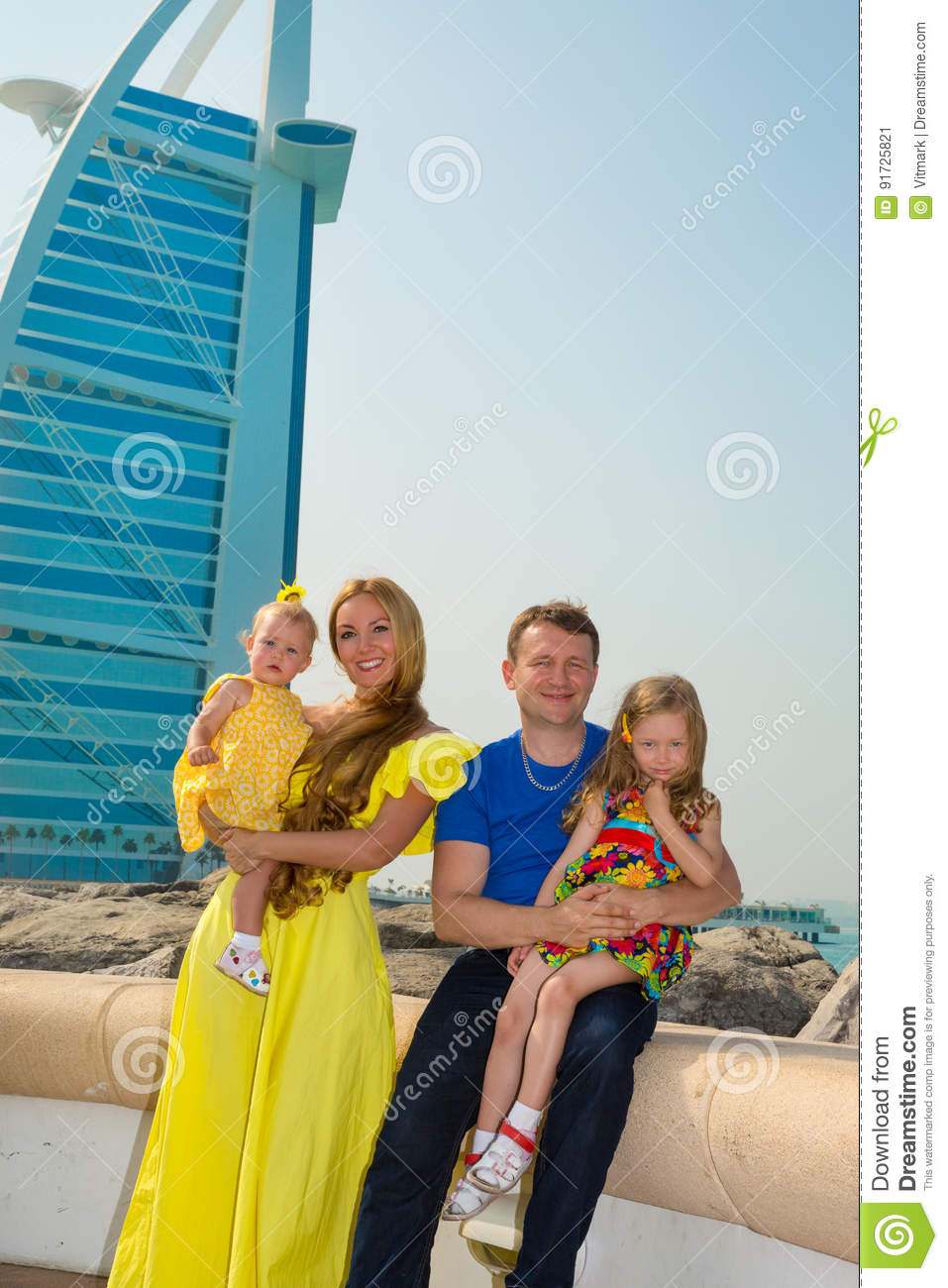 Happy family of father, mother and two children in outdoor on a summer day. Portrait parents and kids on nature.