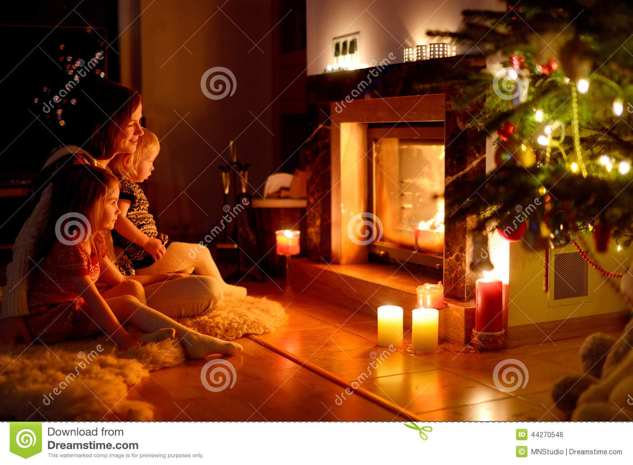 Happy Family By A Fireplace On Christmas Stock Photo Image 44270546