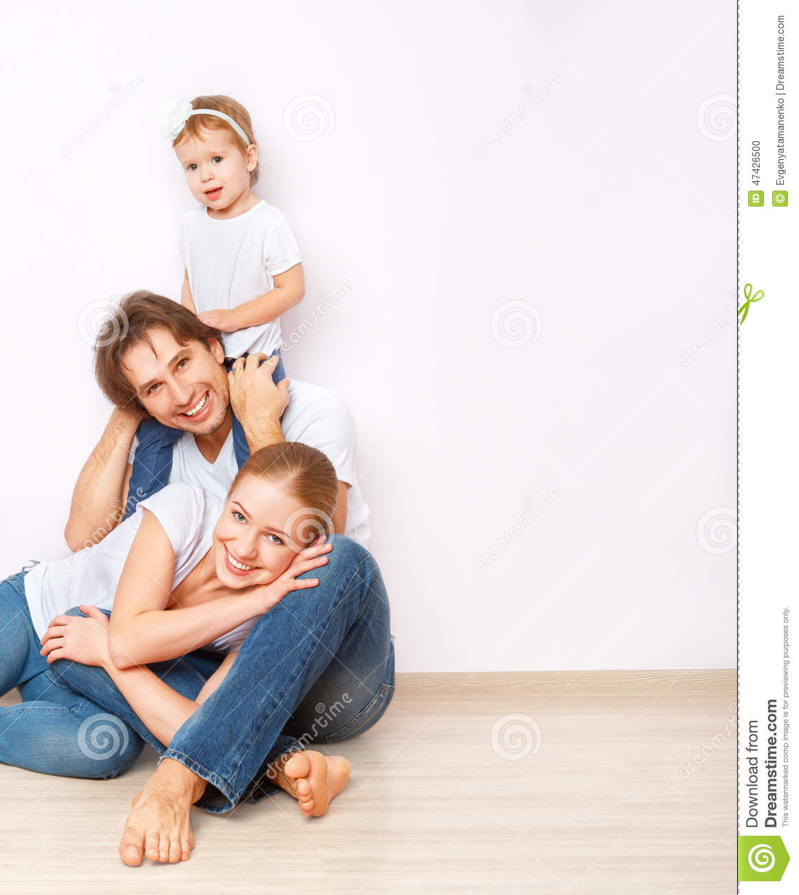 Happy family on floor near empty wall in the apartment for On the floor