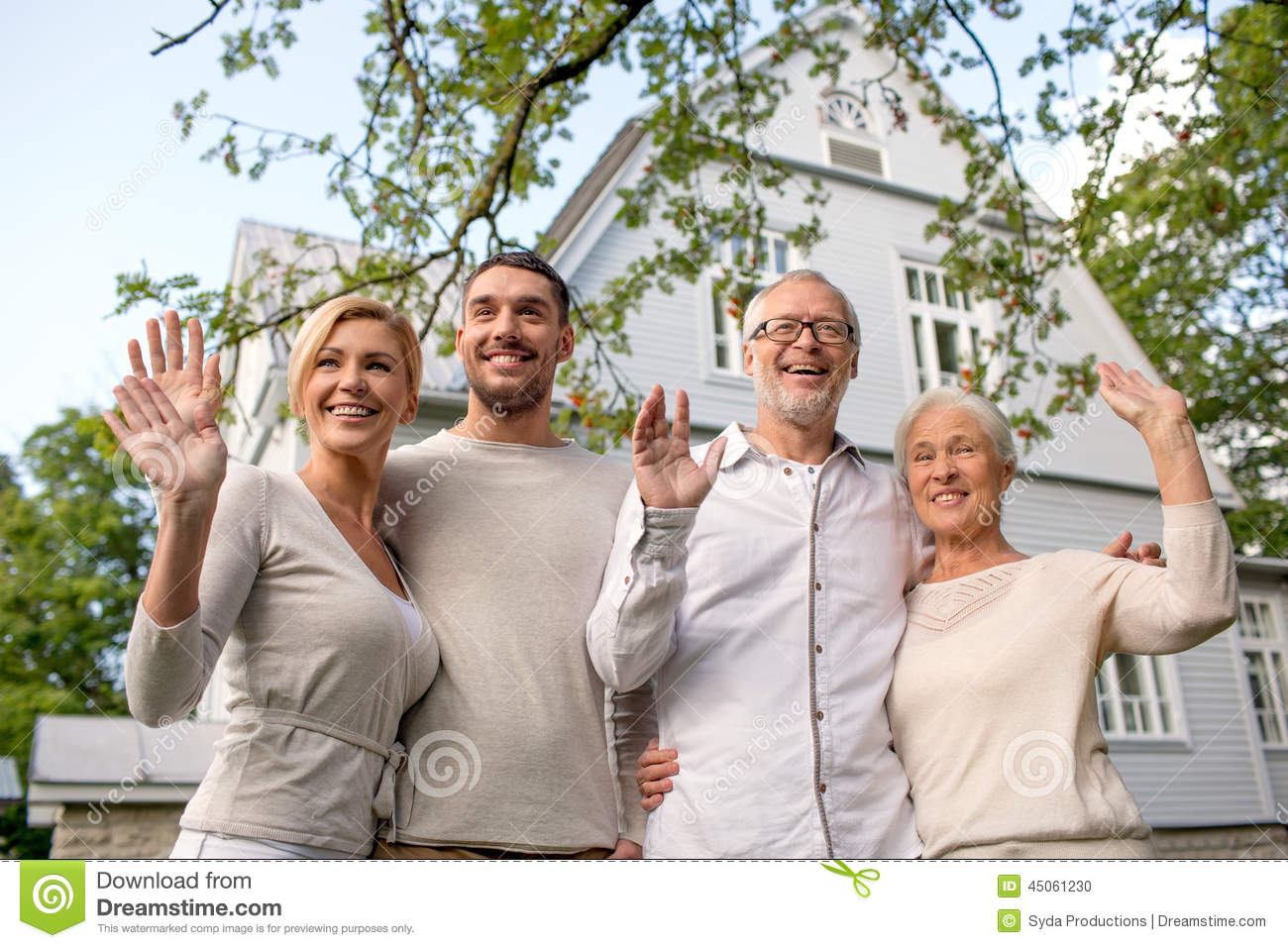 Happy family in front of house outdoors stock photo for Family in house