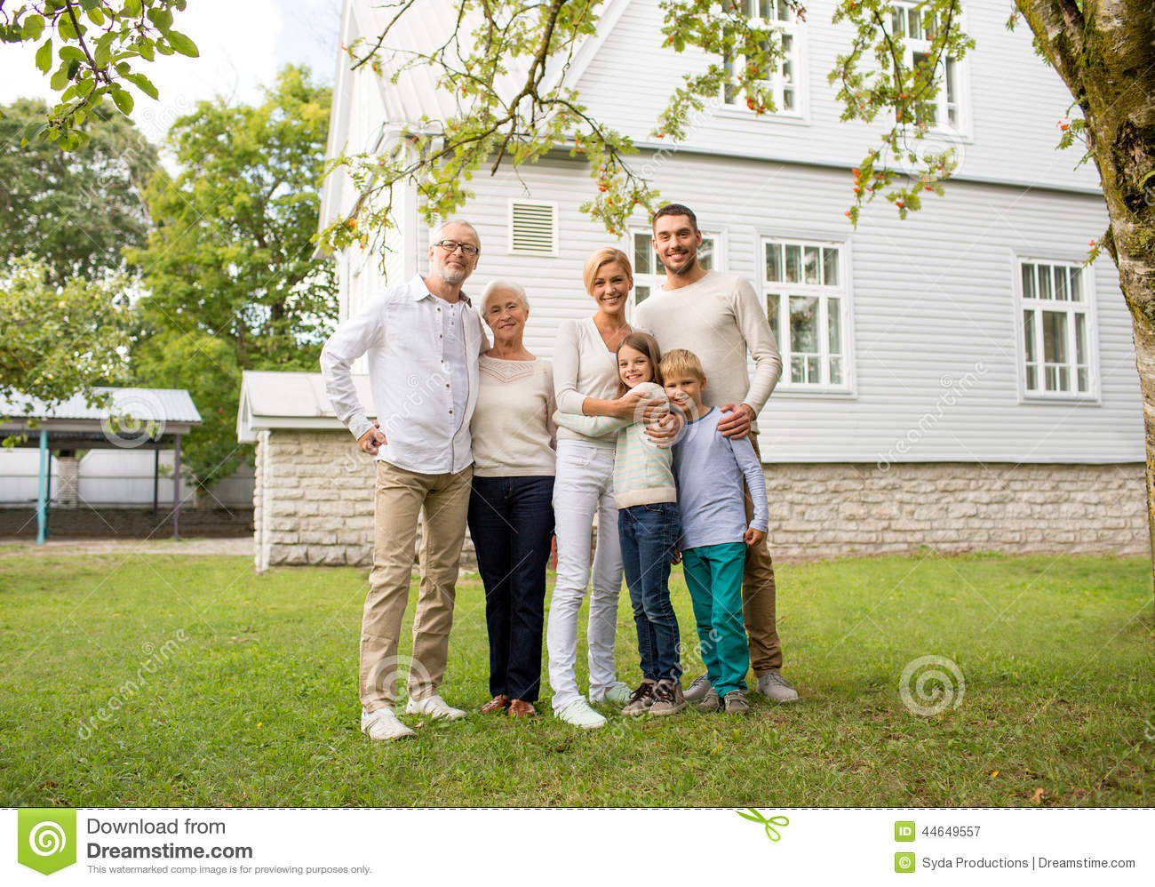 Happy family in front of house outdoors stock image for Generation house