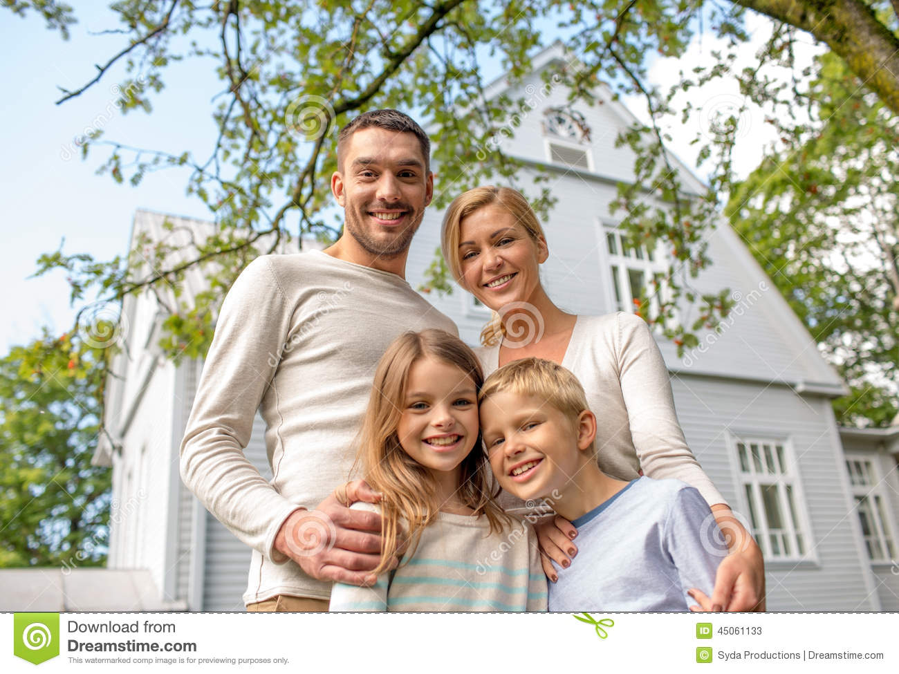 happy family in front of house outdoors stock photo image 45061133. Black Bedroom Furniture Sets. Home Design Ideas