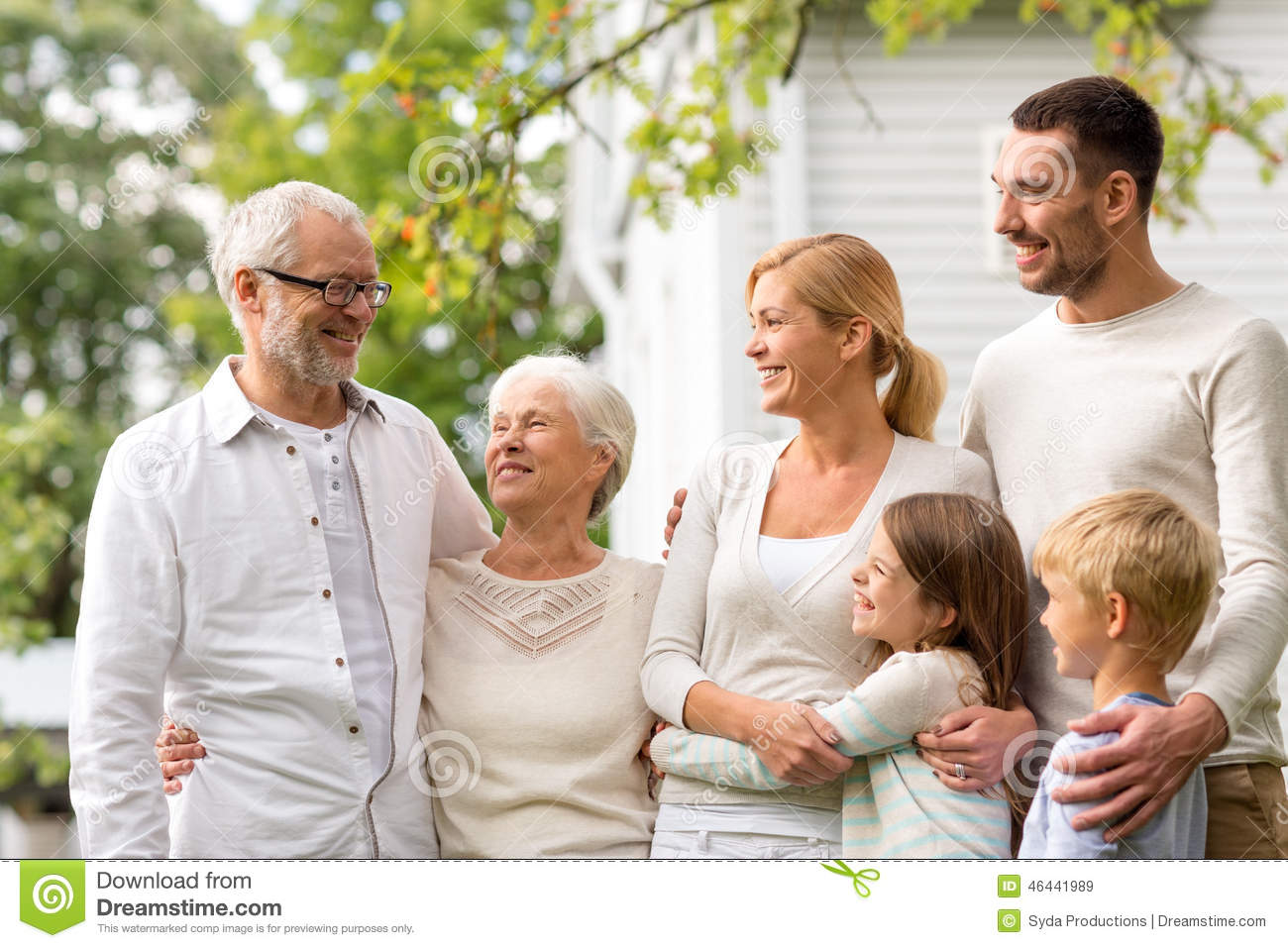 Happy family in front of house outdoors stock photo for Generation house