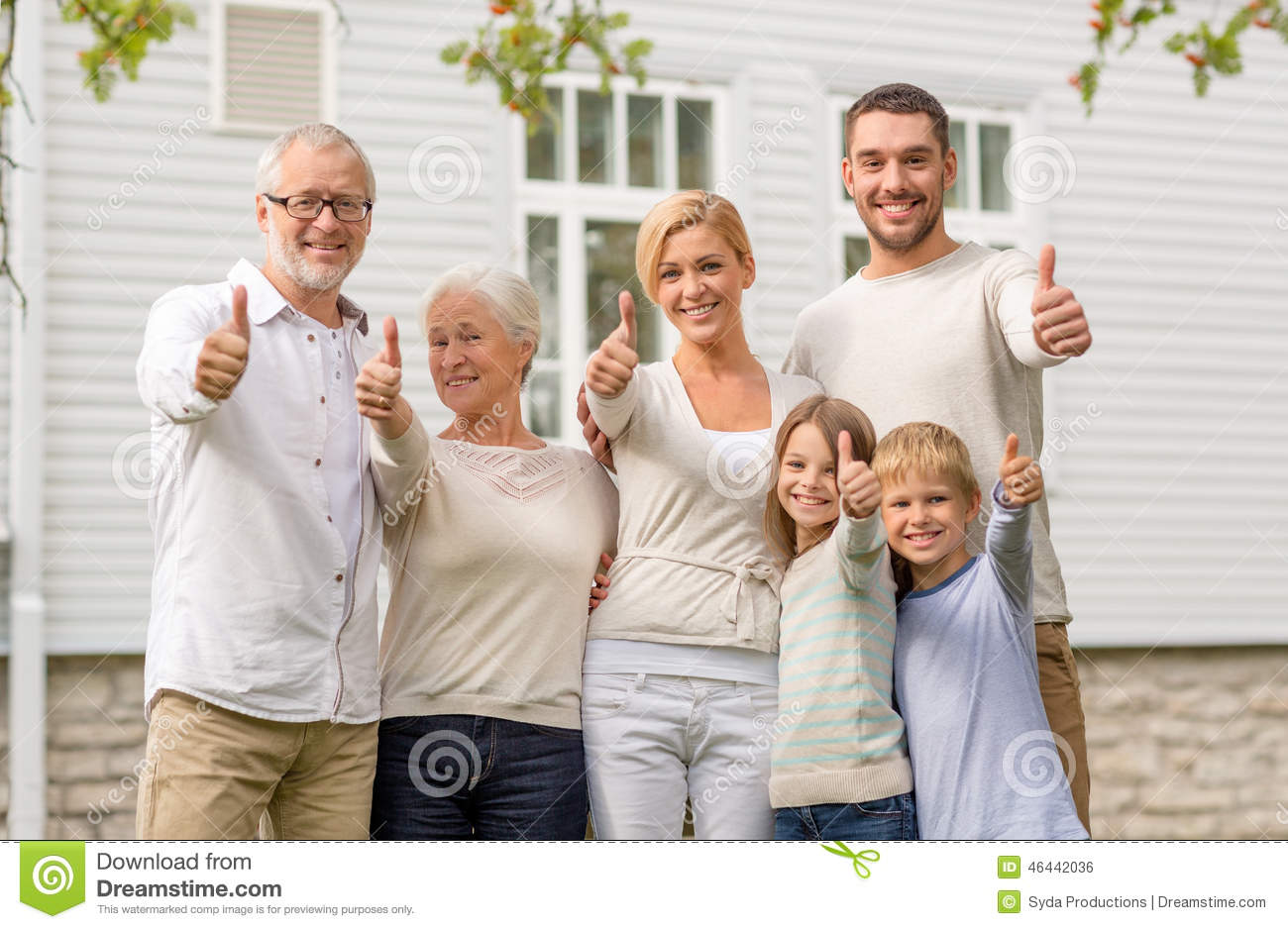 Happy family in front of house outdoors stock photo for What is family home