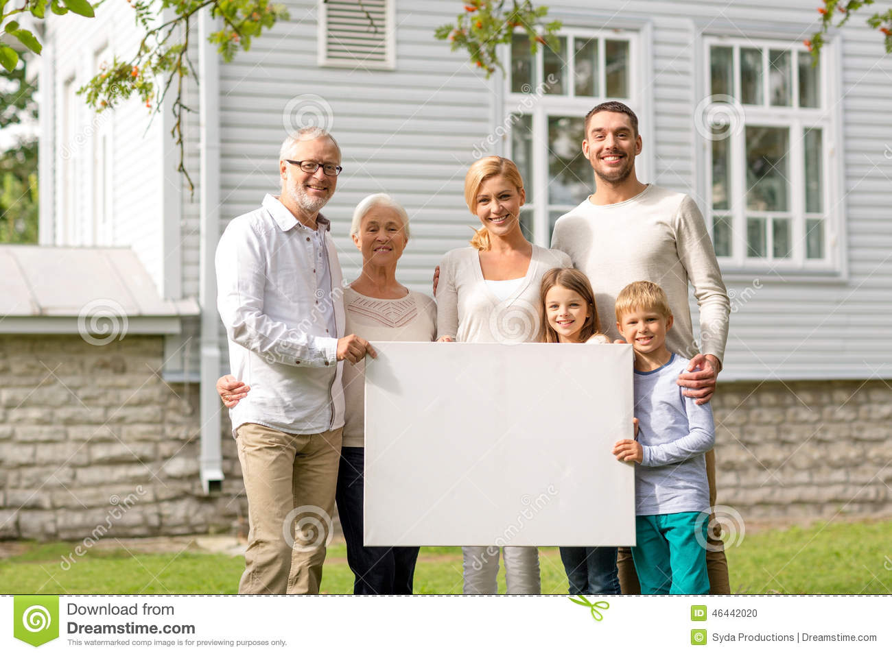 Happy family in front of house outdoors stock photo for A family house