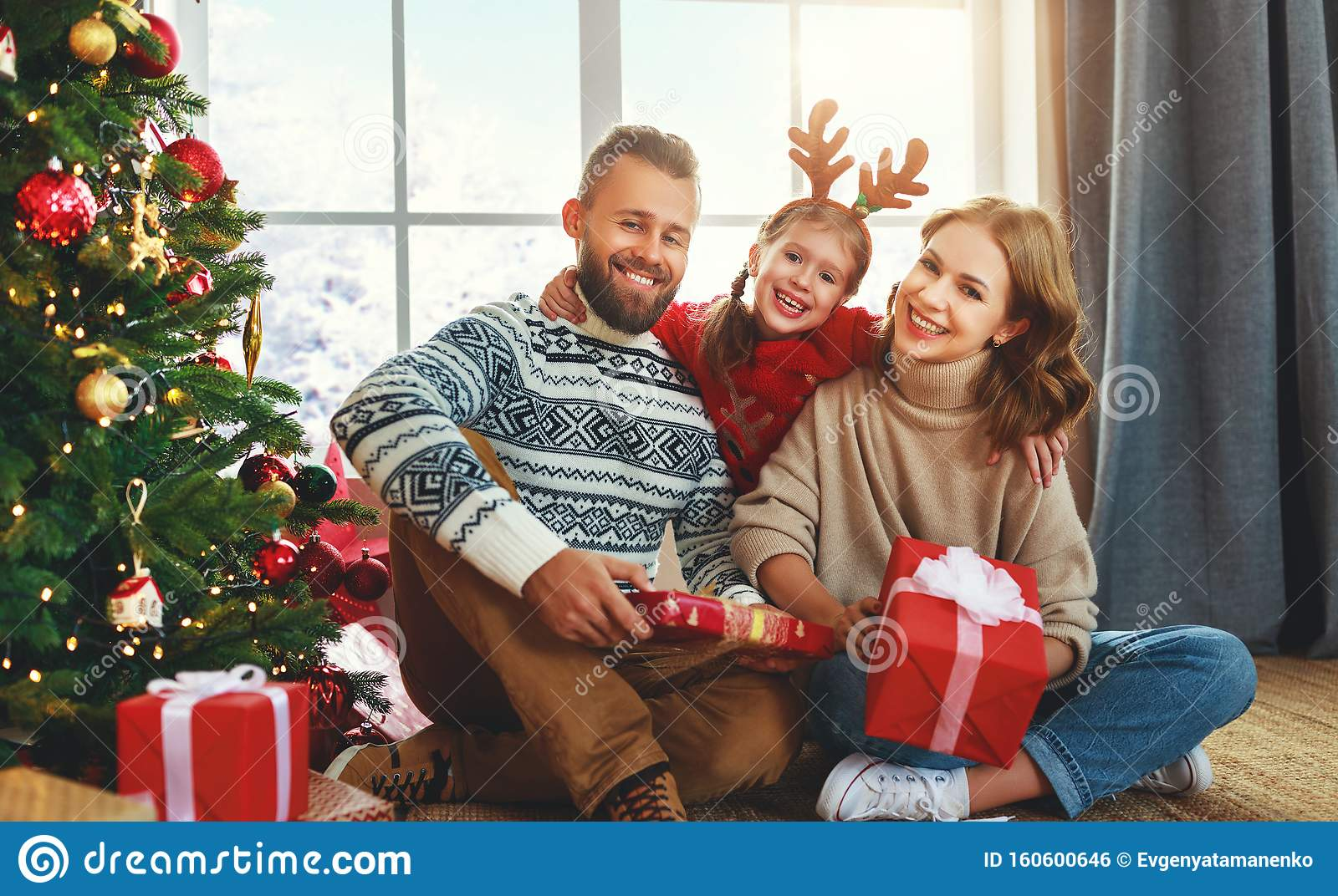 Happy Family With Gifts Near Christmas Tree At Home Stock ...
