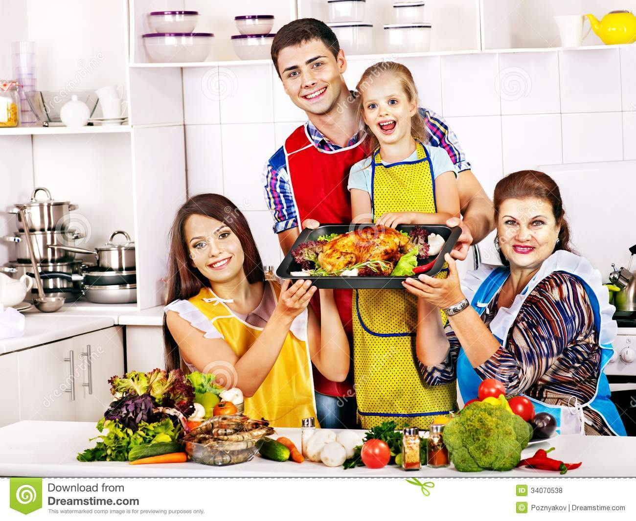 Happy Family With Grandmother At Kitchen Royalty Free