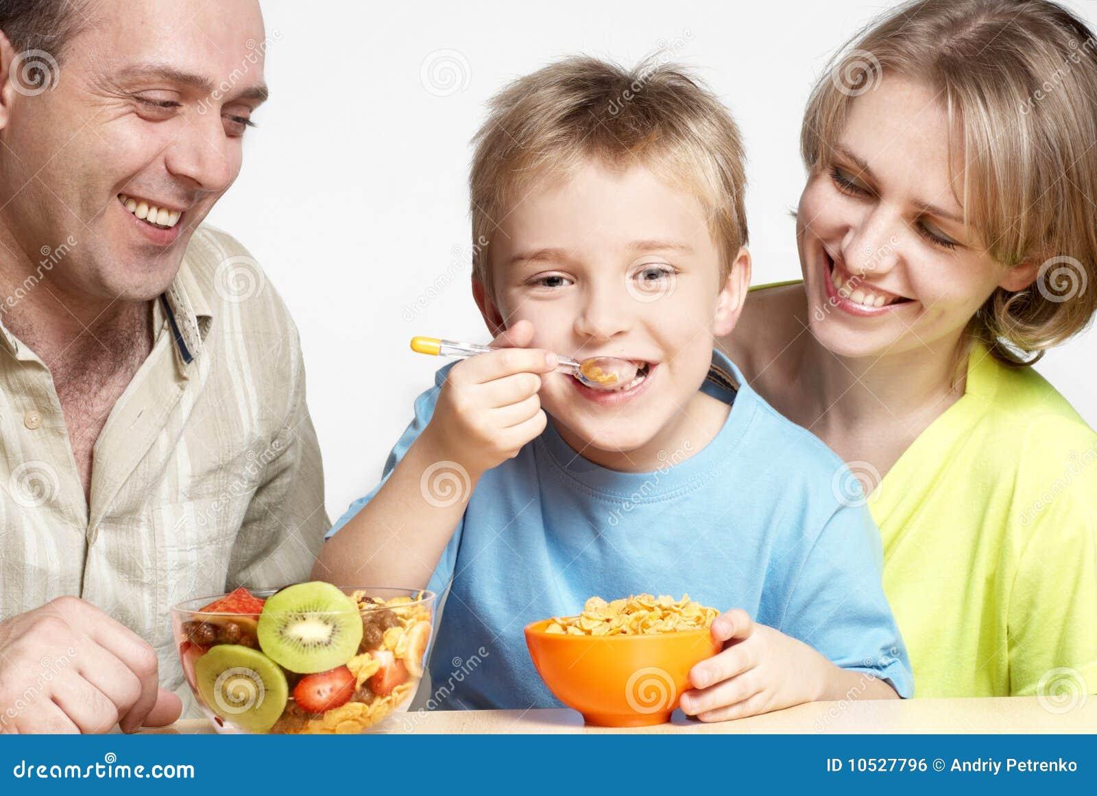The happy family has breakfast