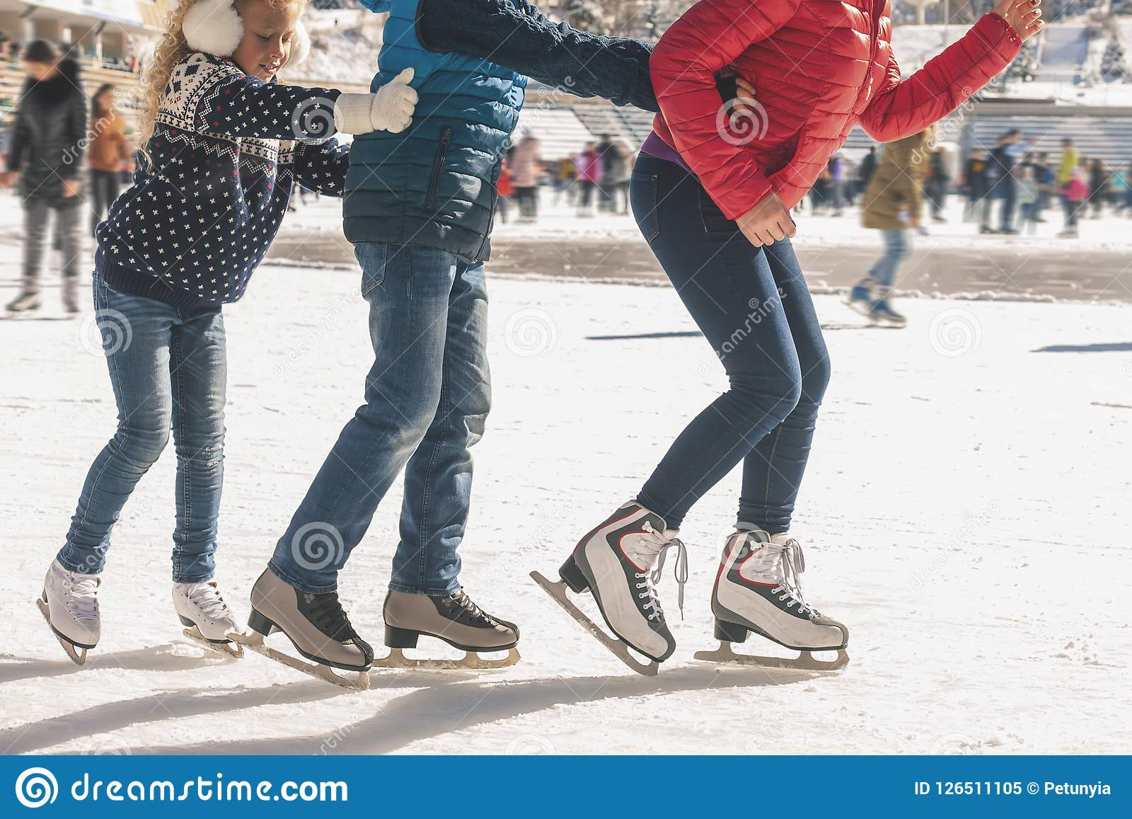 Happy family have outdoor activity, Christmas, outdoor ice skating rink
