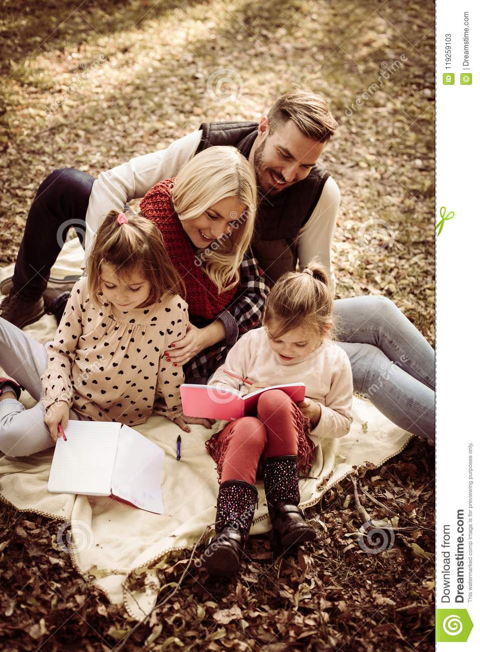 Happy family having educate together.