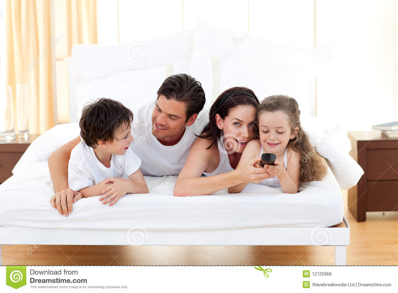 happy family having fun in the bedroom royalty free stock photos