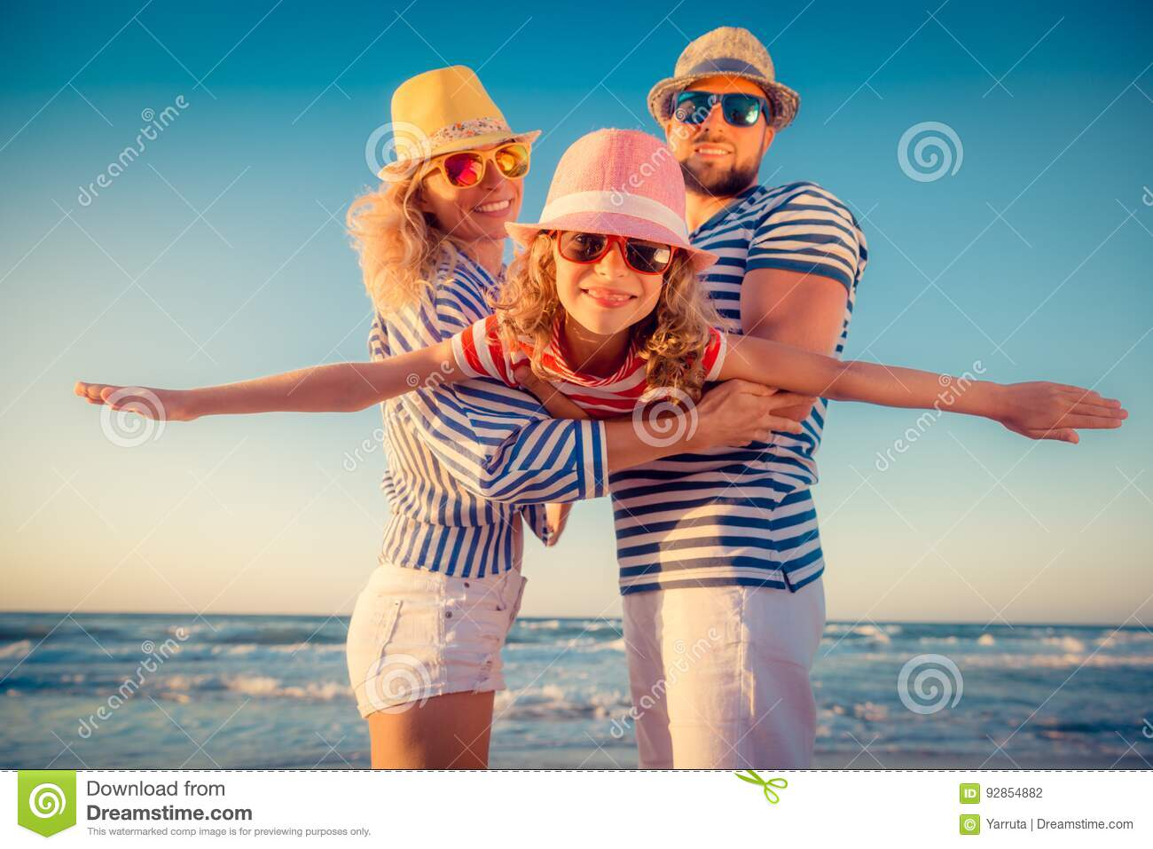 Happy family having fun on summer vacation